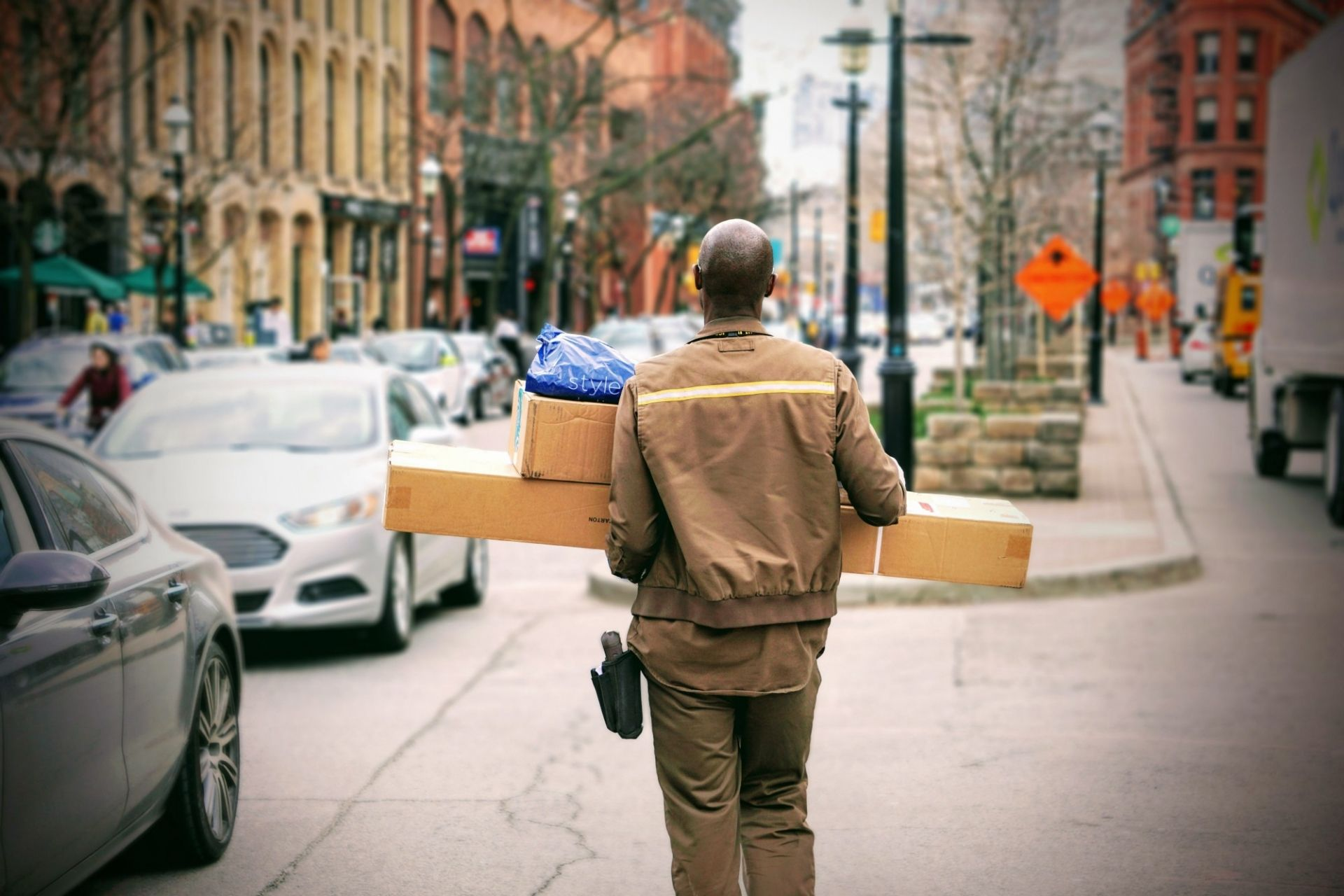 Courier carrying packages